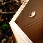 Inside detail of a BGO Bird Box showing drain holes and grooves to help the little fledgelings climb out.